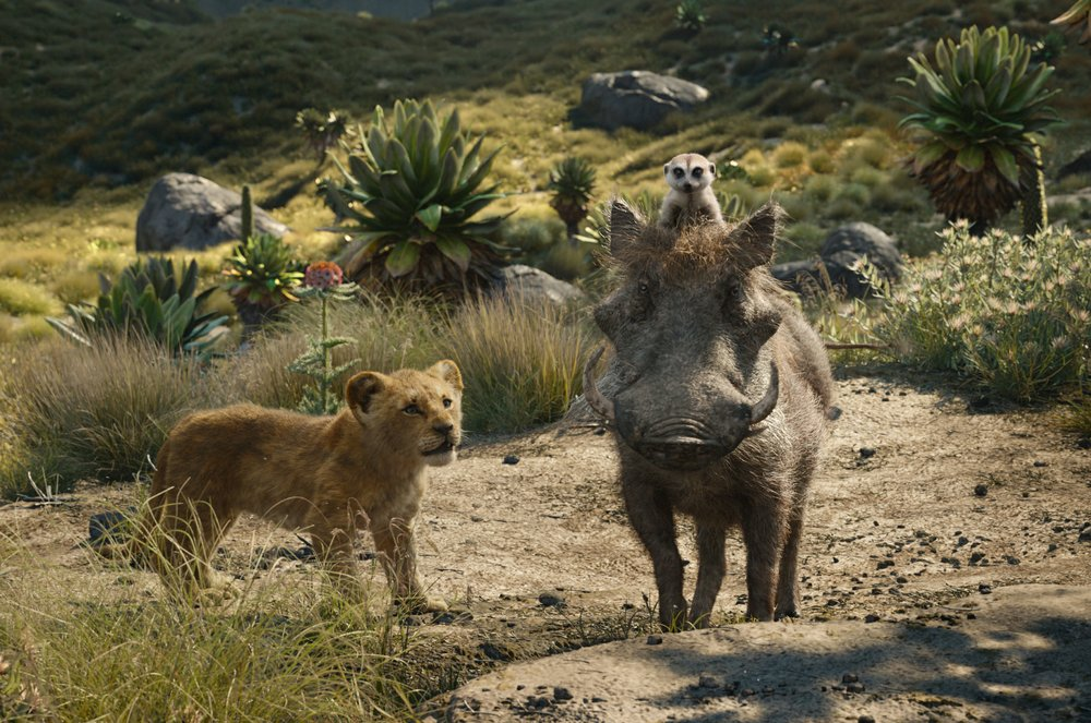 FILE - This file image released by Disney shows, from left, young Simba, voiced by JD McCrary, Timon, voiced by Billy Eichner, and Pumbaa, voiced by Seth Rogen, in a scene from