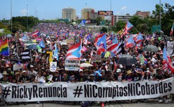 Thousands of Puerto Ricans gather for what many are expecting to be one of the biggest protests ever seen in the U.S. territory, with irate islanders pledging to drive Gov. Ricardo Rossello from office, in San Juan, Puerto Rico, Monday, July 22, 2019. Protesters are demanding Rossello step down for his involvement in a private chat in which he used profanities to describe an ex-New York City councilwoman and a federal control board overseeing the island's finance. (AP Photo/Carlos Giusti)