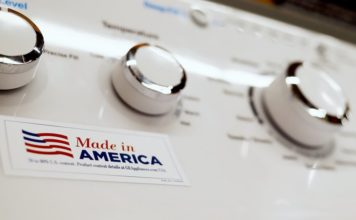 FILE - In this May 9, 2019, file photo a General Electric washing machine with a label advertising it was made in America is displayed in retail stores in Cranberry Township, Pa. China has announced it will raise tariffs on $75 billion of U.S. products in retaliation for President Donald Trump's planned Sept. 1 duty increase in a war over trade and technology policy.(AP Photo/Keith Srakocic, File)