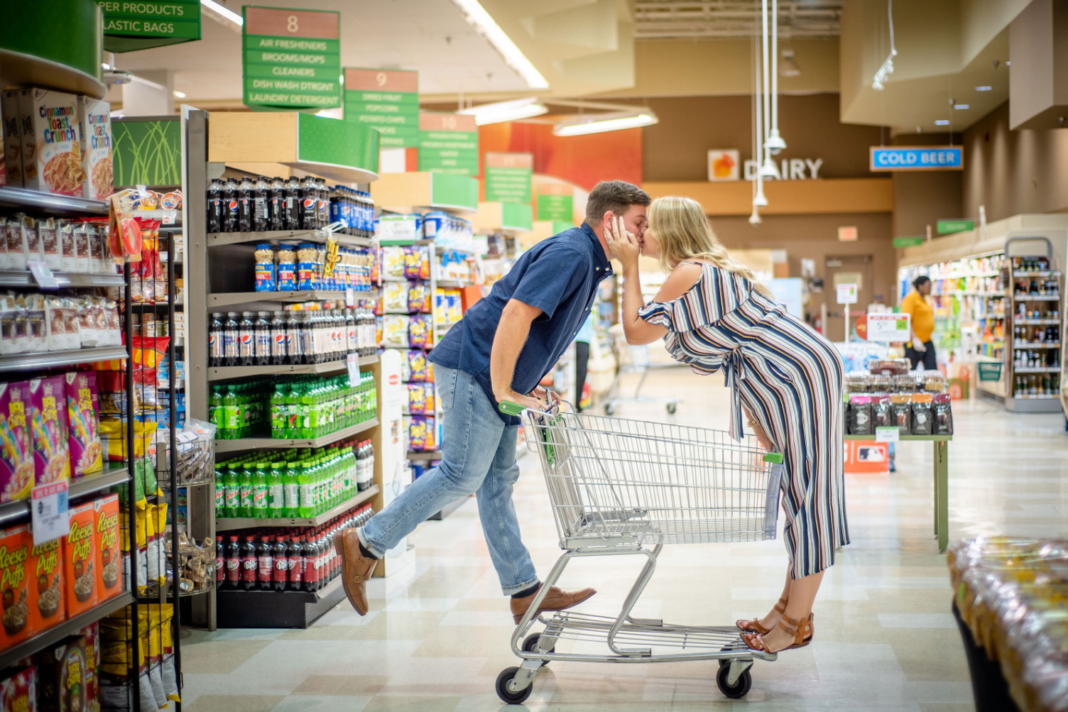 Alexandra Darch and her fiance, Dylan Smith, posing in one of their engagement photos at Publix. (Credit:: Jennifer Goodlet Photography)