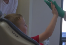Boy high-fives dentist after a free exam. (Credit: WINK News)