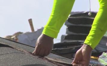 Construction worker does roof repairs. (Credit: WINK News)