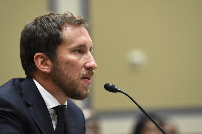 FILE - In this July 25, 2019, file photo, JUUL Labs co-founder and Chief Product Officer James Monsees testifies before a House Oversight and Government Reform subcommittee on Capitol Hill in Washington. Juul Labs gave nearly $100,000 to members of Congress during the first half of 2019 as the company faced the bulk of the blame for a surge of underage vaping and calls for tighter government regulation of the industry.(AP Photo/Susan Walsh, File)