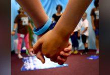 Kids holding hands, generic (US Air Force / Nick Daniello via MGN)