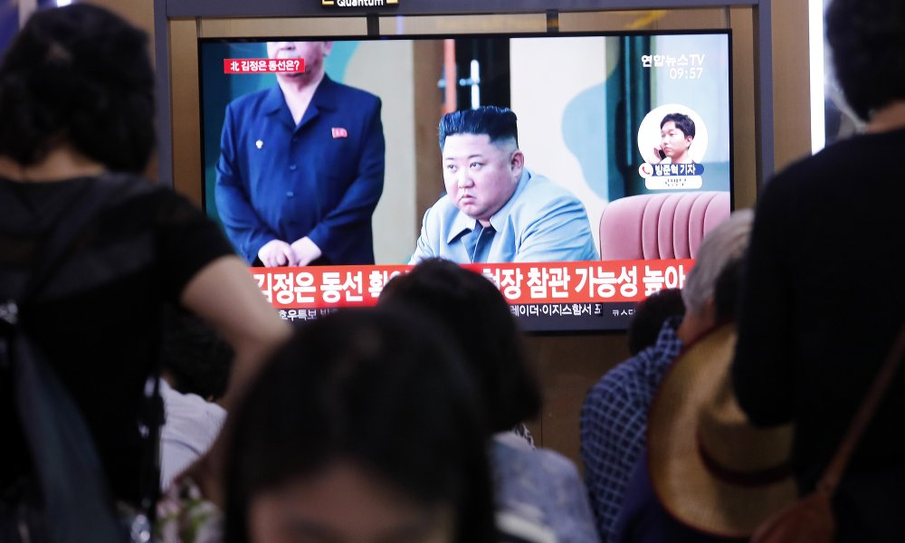 People watch a TV showing a file image of North Korean leader Kim Jong Un during a news program at the Seoul Railway Station in Seoul, South Korea, Wednesday, July 31, 2019. North Korea fired two short-range ballistic missiles off its east coast Wednesday, South Korea's military said, its second weapons test in less than a week. (AP Photo/Ahn Young-joon)