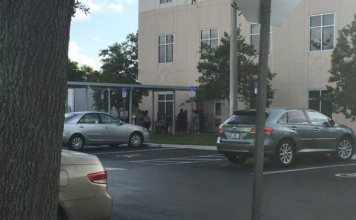Registration wait on Wednesday outside the Collier County Public Schools administration building. (Credit: WINK News)