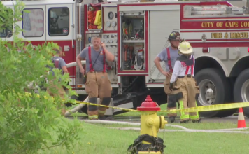 Scene from the fire around the NW Cape Coral home on Wednesday. (Credit: WINK News)