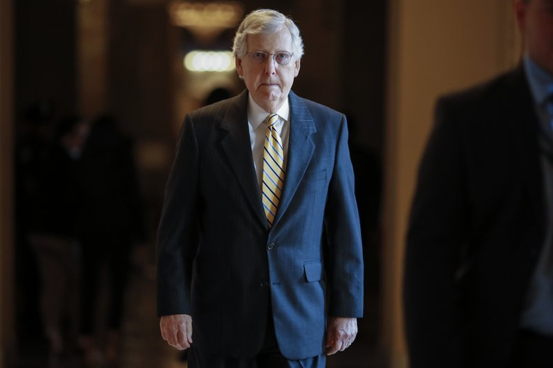 Senate Majority Leader Mitch McConnell, R-Ky., walks to the Senate chamber for votes on federal judges as a massive budget pact between House Speaker Nancy Pelosi and President Donald Trump is facing a key vote in the GOP-held Senate later, at the Capitol in Washington, Wednesday, July 31, 2019. Many conservatives in the Republican-led Senate are torn between supporting President Donald Trump and risking their political brand with an unpopular vote to add $2 trillion or more to the federal debt. (AP Photo/J. Scott Applewhite)