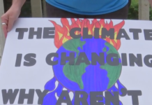 Sign from a protester at the Naples rally Friday. (Credit: WINK News)