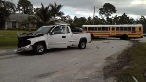 Vehicle damage from crash into school bus Monday morning. (Credit: FHP)
