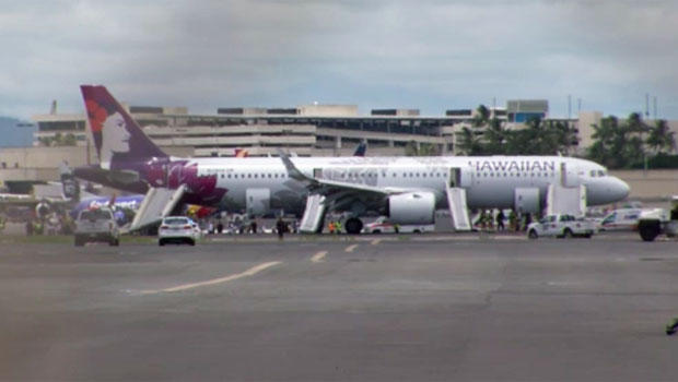 Hawaiian Airlines flight is seen following emergency landing in Honolulu after smoke filled its cabin and cargo hold on Auguest 22, 2019 (KGMB-TV via CBS)