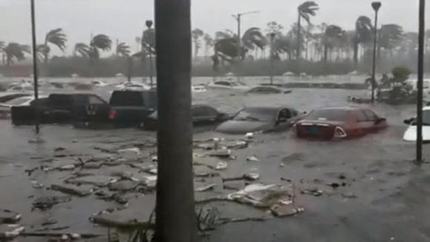 The deadly storm, which was stuck in place over the island nation, has been pounding the northern Bahamas for nearly two days. (CBSNews)
