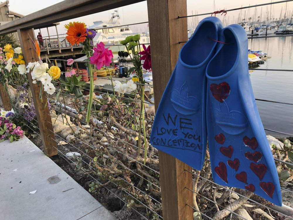 A memorial outside Truth Aquatics for the victims of the Conception boat fire, Monday, Sept. 2, 2019. A fire raged through a boat carrying recreational scuba divers anchored near an island off the Southern California coast early Monday, leaving multiple people dead and hope diminishing that any of the more than two dozen people still missing would be found alive. (AP Photo/Stefanie Dazio)