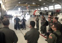 Coast Guard air crews and health service technicians are briefed at Coast Guard Air Station Clearwater before a C-130 flight to Andros Island in preparation for Hurricane Dorian response, Sept. 2, 2019. The Coast Guard prestages and relocates personnel and assets to be able to have a rapid post-storm response. (U.S. Coast Guard photo by Petty Officer 1st Class Ayla Kelley.)