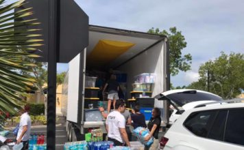 People in Naples load a truck to send donated goods to those affected by Hurricane Dorian in the Bahamas (Collier County Sheriff's Office)