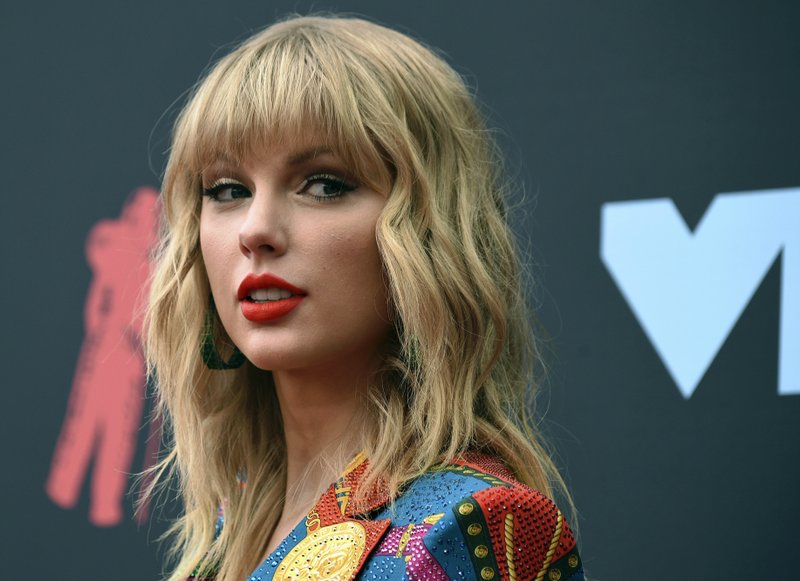 FILE - In this Aug. 26, 2019 file photo, Taylor Swift arrives at the MTV Video Music Awards in Newark, N.J. Richard Joseph McEwan, of Milford, N.J., was arrested on Friday, Aug. 30, and charged with breaking into Swift's Westerly, R.I., oceanfront house. (Photo by Evan Agostini/Invision/AP, File)