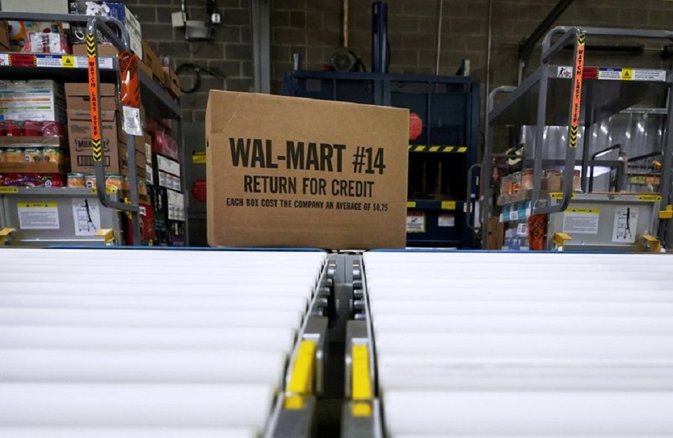 FILE - In this Nov. 9, 2018, file photo, a box of merchandise is unloaded from a truck and sent along a conveyor belt at a Walmart Supercenter in Houston. Walmart is rolling out an unlimited grocery delivery subscription service this fall for a $98 annual fee. The service will reach 1,400 stores in 200 markets and allows the nation's largest grocer to further tap into time-starved shoppers looking for convenience. (AP Photo/David J. Phillip, File)