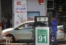 """A worker refuels a car at a gas station in Jiddah, Saudi Arabia, Monday, Sept. 16, 2019. Global energy prices spiked on Monday after a weekend attack on key oil facilities in Saudi Arabia caused the worst disruption to world supplies on record, an assault for which President Donald Trump warned that the U.S. was """"locked and loaded"""" to respond. (AP Photo/Amr Nabil)"""