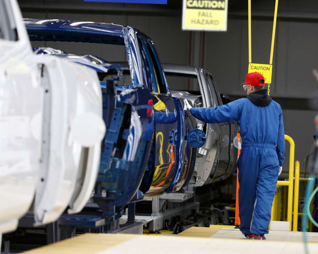 Members of the United Auto Workers union working at General Motors agreed Saturday night to stay on the job past a midnight deadline for a new contract, but remained on the verge of a strike. (Credit: CNN)