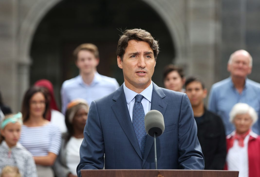 Canadian Prime Minister Justin Trudeau apologized Wednesday after a photo emerged of him wearing brownface during a school event in 2001.