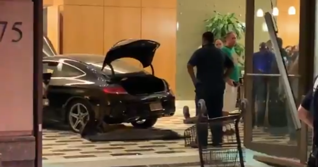 Car crashes through lobby at Trump Plaza in Westchester, New York (Credit: CBS News)