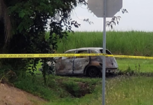 Charred car where a woman may have died. (Credit: WINK News)