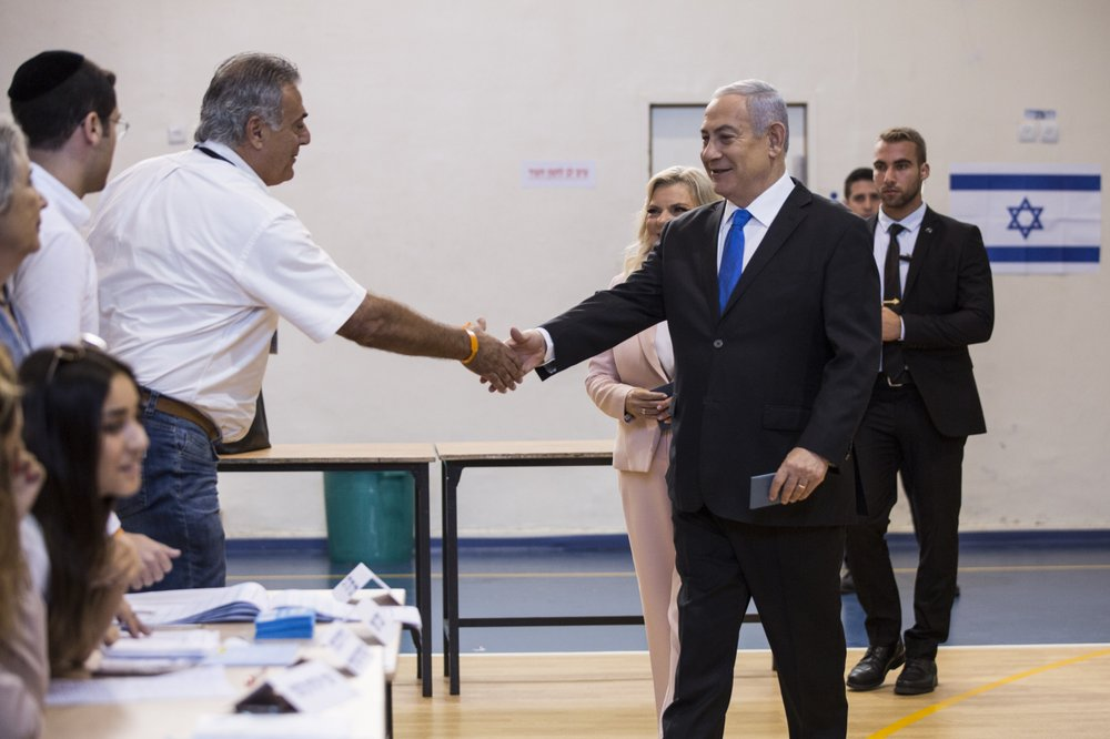 Israeli Prime Minister Benjamin and his wife Sarah arrive at a voting station in Jerusalem on September 17, 2019. Israelis began voting Tuesday in an unprecedented repeat election that will decide whether longtime Prime Minister Benjamin Netanyahu stays in power despite a looming indictment on corruption charges. (Heidi Levine, Sipa, Pool via AP).