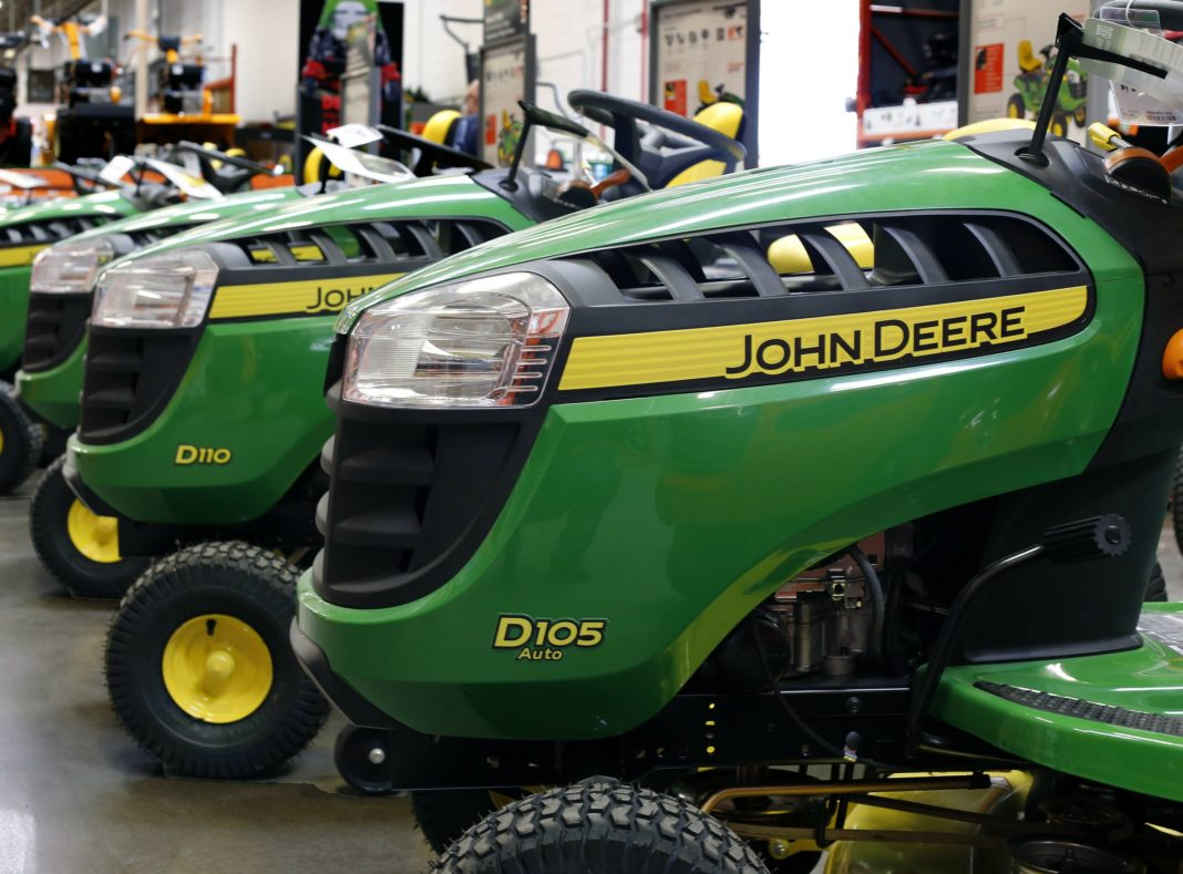 FILE - In this March 23, 2015, file photo, John Deere lawn tractors are on display at a Home Depot in Robinson Township, Pa. Wall Street is flooding into the agricultural sector on reports that the Trump administration is preparing a plan that would send billions in aid to U.S. farmers hurt by tariffs. CF Industries Holding and Mosaic Company both traded up more than 3 percent, while Deere & Co. shot up more than 4 percent after news of the aid package was leaked to The Associated Press by two people briefed on the plan. (AP Photo/Gene J. Puskar, File)
