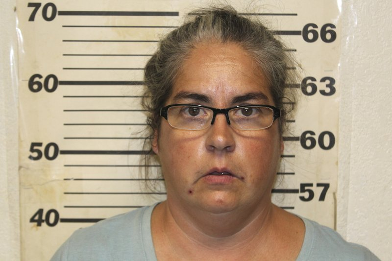 This undated photo provided by the Benton County, Mo., Sheriff's Office in Warsaw, Mo., shows Tiffany Woodington, whe was charged Friday, Sept. 20, 2019, in Missouri with 10 counts of felony animal abuse and two misdemeanor counts of animal abuse. Her husband, Steven Woodington, was charged Thursday in Texas with animal cruelty. A second man described as the caretaker also was charged in Texas with animal cruelty. All three are free on bond. face multiple charges after 120 dogs and a cat were found dead in Missouri and about two dozen more dogs died in Texas. More than 200 other animals were rescued from conditions that law enforcement described as