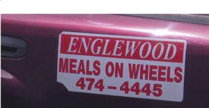 Sticker on Meals on Wheels vehicles. (Credit: WINK News)
