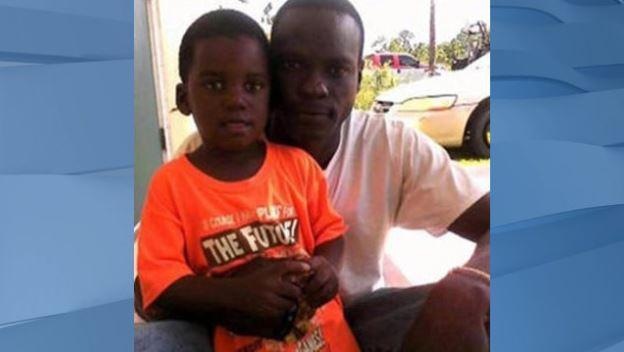 Adrian Farrington with his son, A.J. (Family photo via CBS News)