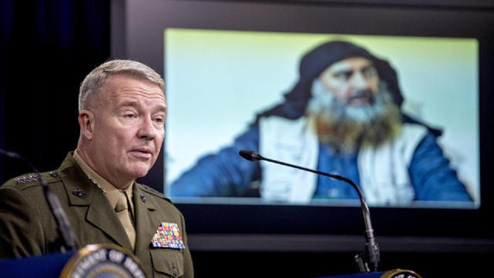 Abu Bakr al-Baghdadi is displayed on a monitor as U.S. Central Command Commander Marine Gen. Kenneth McKenzie speaks at a joint press briefing at the Pentagon in Washington, Wednesday, Oct. 30, 2019, on the Abu Bakr al-Baghdadi raid. (ANDREW HARNIK / AP)