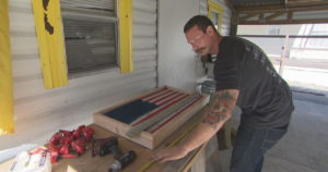Florida firefighter turns old fire hoses into works of art. (Credit: CBS News)