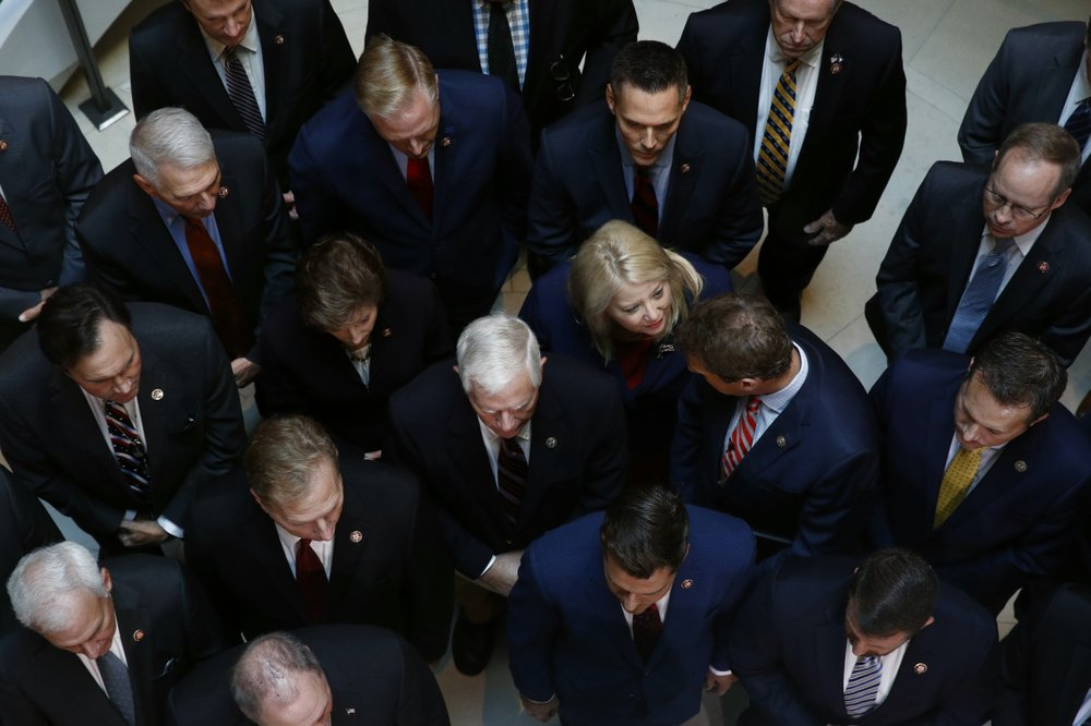 Rep. Debbie Lesko, R-Ariz., center, gathers with fellow House Republicans for a news conference after Deputy Assistant Secretary of Defense Laura Cooper arrived for a closed door meeting to testify as part of the House impeachment inquiry into President Donald Trump, Wednesday, Oct. 23, 2019, on Capitol Hill in Washington. (AP Photo/Patrick Semansky)