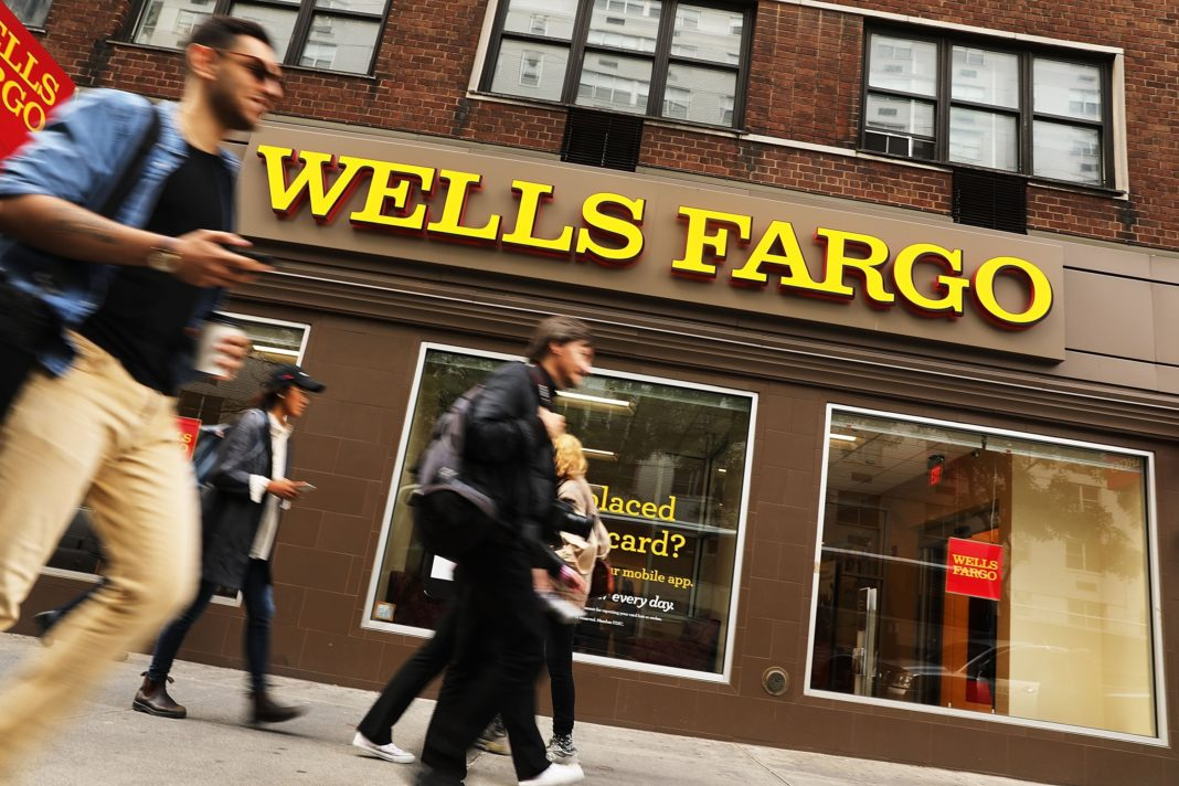 Wells Fargo's fake-account scandal continues to haunt the big bank, exacerbating headaches caused by shrinking interest rates. Wells Fargo revealed a 23% drop in third-quarter. (Credit CNN)