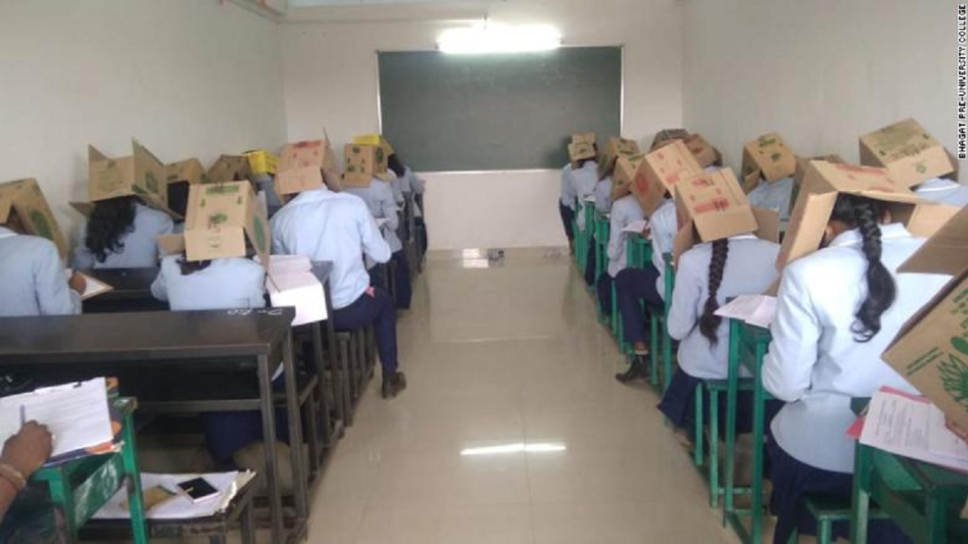 Students at an Indian school wore cardboard boxes on their heads as an anti-cheating measure on October 16, 2019.