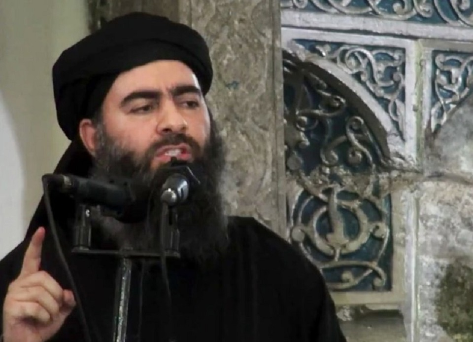 FILE - This file image made from video posted on a militant website Saturday, July 5, 2014, purports to show the leader of the Islamic State group, Abu Bakr al-Baghdadi, delivering a sermon at a mosque in Iraq during his first public appearance. The leader of the Islamic State militant network is believed dead after being targeted by a U.S. military raid in Syria. A U.S. official told The Associated Press late Saturday, Oct. 26, 2019, that Abu Bakr al-Baghdadi was targeted in Syria's Idlib province. (AP Photo/Militant video, File)