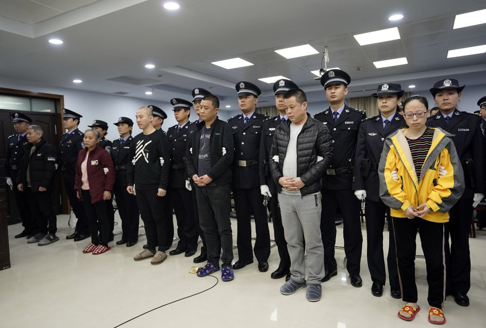 A trial continues as fentanyl drug traffickers are sentenced in court, Thursday, Nov. 7, 2019, in Xingtai, north China's Hebei Province. The court sentenced at least nine fentanyl traffickers Thursday in a case that was a culmination of a rare collaboration between Chinese and U.S. law enforcement to crack down on global networks that manufacture and distribute lethal synthetic opioids. (Jin Liangkuai/Xinhua via AP)