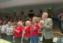 Attendees applaud at the ceremony on Veterans Day. (Credit: WINK News)