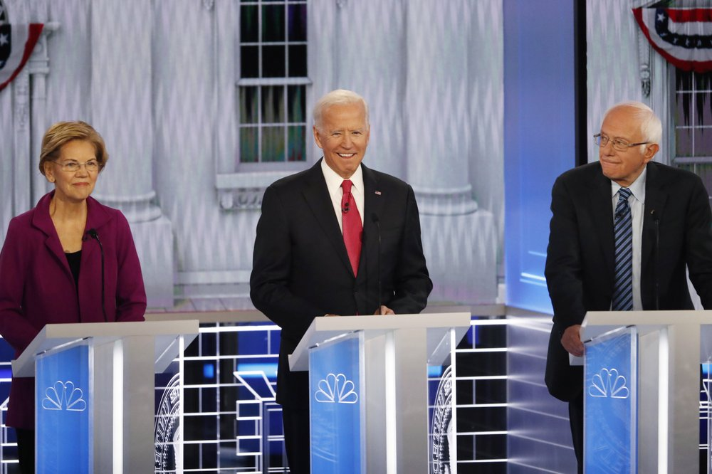 From left, Democratic presidential candidates Sen. Elizabeth Warren, D-Mass., former Vice President Joe Biden and Sen. Bernie Sanders, I-Vt., participate in a Democratic presidential primary debate, Wednesday, Nov. 20, 2019, in Atlanta. (AP Photo/John Bazemore)