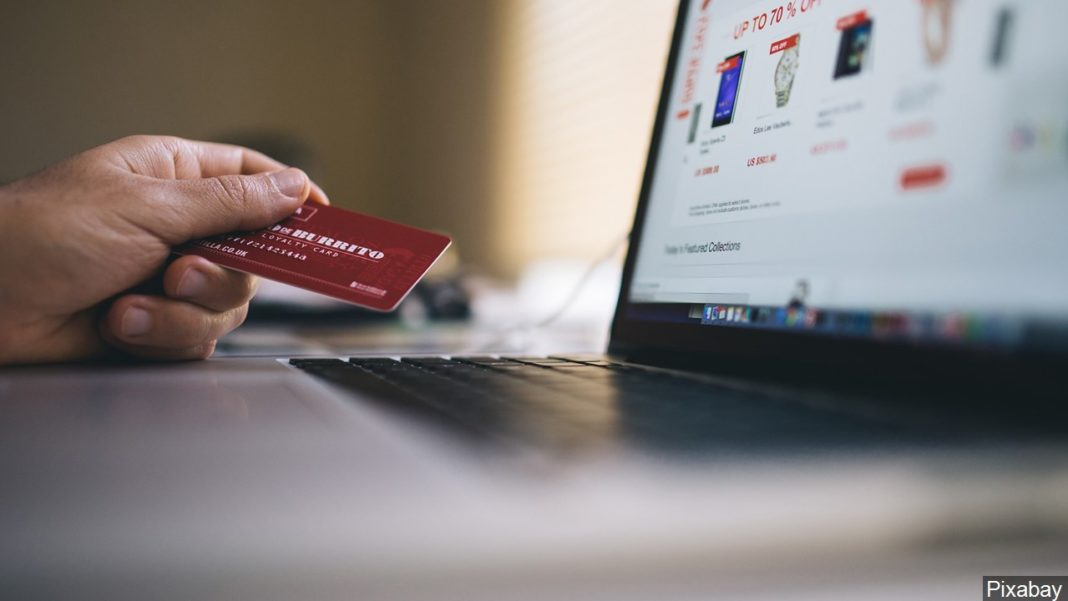 Holiday online shopping illustration. (Credit: MGN)