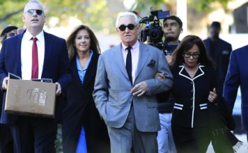 Roger Stone, with his wife, Nydia Stone, right, arrive at the federal court in Washington, Tuesday, Nov. 5, 2019. Stone, a longtime Republican provocateur and former confidant of President Donald Trump, goes on trial over charges related to his alleged efforts to exploit the Russian-hacked Hillary Clinton emails for political gain. (AP Photo/Manuel Balce Ceneta)