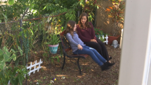 Angela Melvin, founder of Valerie's House, comforts Sydney Emery, 9 years old, who lost her mother at around the same young age as Melvin. (Credit: WINK News)