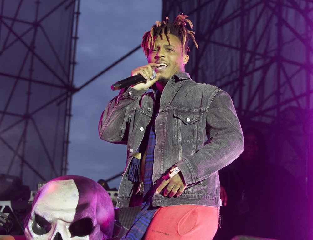 FILE - In this May 15, 2019 file photo, Juice WRLD performs in concert during his