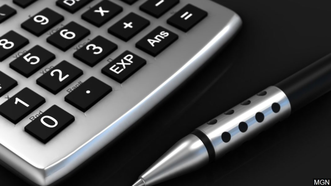 Calculator to use while filing federal income tax withholding forms. (Credit: MGN)