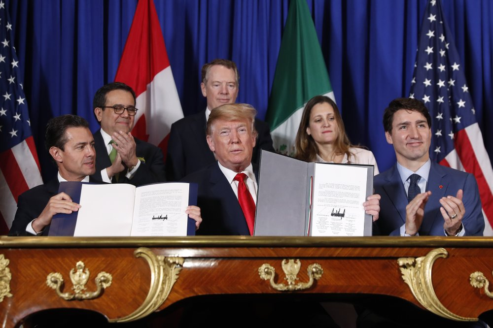 FILE: President Donald Trump, Canada's Prime Minister Justin Trudeau, right, and Mexico's President Enrique Pena Neto, left, participate in the USMCA signing ceremony, Friday, Nov. 30, 2018 in Buenos Aires, Argentina. (AP Photo/Pablo Martinez Monsivais/FILE)