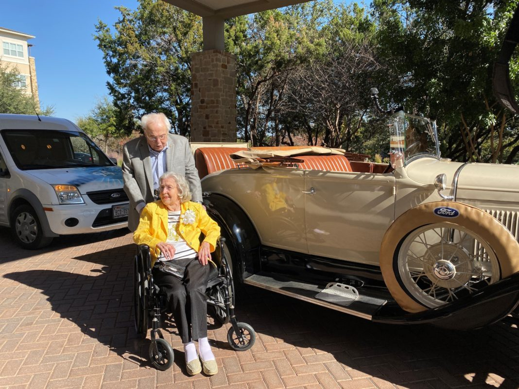 To celebrate their 80th year together, 106-year-old John Henderson picked up 105-year-old Charlotte Henderson in a 1920's Roadster -- much like he did on their first date -- with a beautiful bouquet of flowers. (Credit: Longhorn Village Senior Living Community)