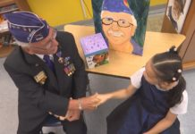 Student and a veteran shake hands. (Credit: WINK News)