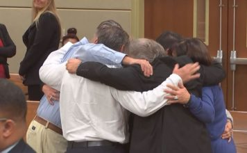 FILE: The family of Dr. Teresa Sievers embrace one another after a jury finds her husband, Mark Sievers, guilty of first-degree murder in her vicious killing at their Bonita Springs home in 2015. (Credit: WINK News./FILE)
