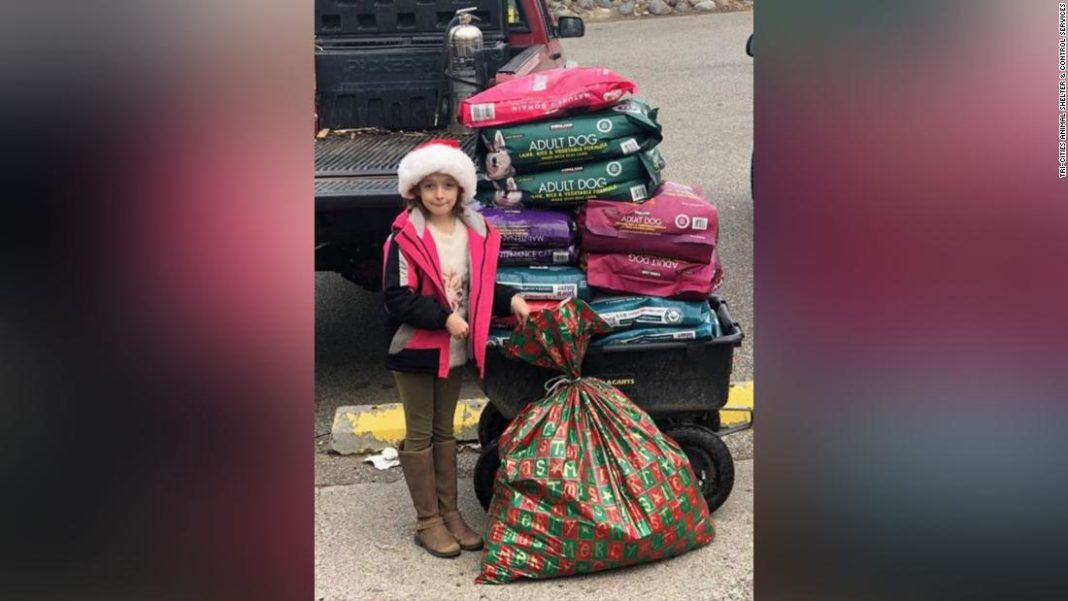 The 8-year-old's Christmas wish was to help the dogs and cats at the Tri-Cities Animal Shelter, so she asked for money to buy pet food for Christmas instead of toys. (Credit: CNN)